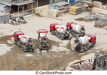 Concrete mixers, tractor and construction materials on big...