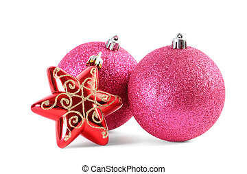 Two red Christmas tree balls and star isolated on white, focus on front ball and star