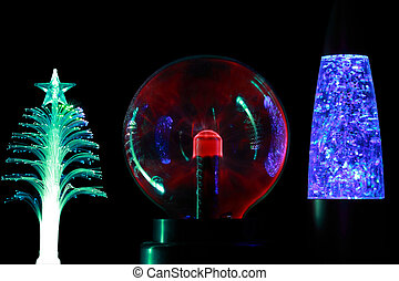 Three souvenir lamps of different form: conifer, round red...