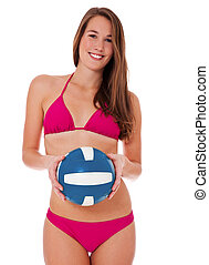 Woman with volleyball - Attractive woman in bikini holding a...