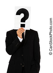 Question - Businessman holding question mark in front of his...