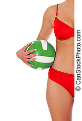 Beach volleyball - Attractive woman in bikini holding a...