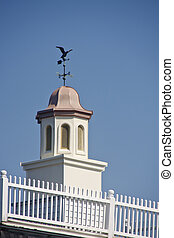 Copper Roof on Cupola with Weather Vane - A copper roof on a...