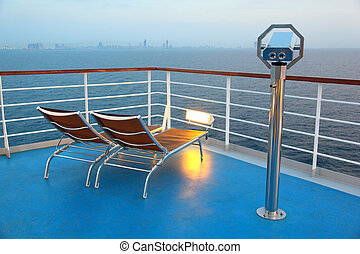 Two illuminated deck-chair and binocular on ship overlooking...
