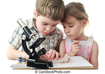 Curious little boy and girl draw diagram near black...