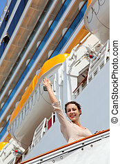 Smiling girl on ladder goes to cruise ship and wave by...