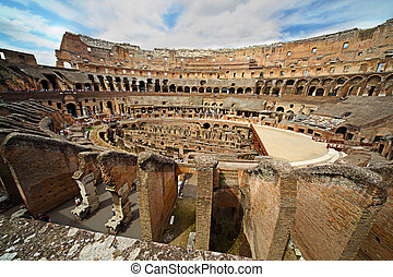 Near center of arena in ancient Coliseum in Rome, Italy with...