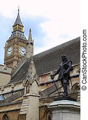 Statue of Oliver Cromwell at Westminster and Big Ben Clock Tower in London. Oliver Cromwell – is english revolutionary, regicide and lord protector