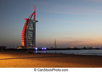 DUBAI - APRIL 17: Burj Al Arab skyscraper near evening beach...