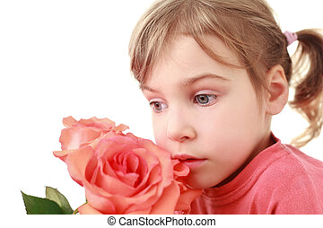 Girl was concentrated and smells large rose, focus on face
