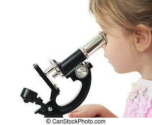 Portrait of curious little blonde girl staring into black microscope