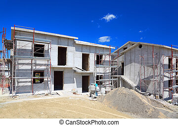 Building of new two-story white concrete house with stairs...