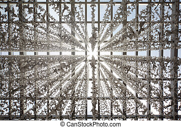 glass ceiling in public building decored with butterfly garlands, abstract background