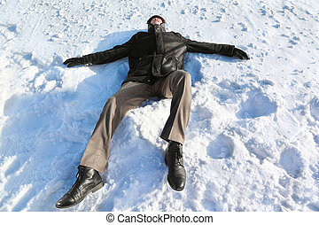 Man lies on back by  winter day and rests closing eyes