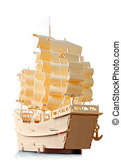 Homemade wooden ship with paper sails and flag, view from...