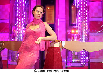 beautiful woman wearing evening dress standing in...