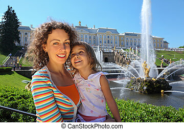 Mother with daughter  near fountains of Petergof, Saint Petersburg, Russia