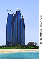 ABU DHABI, UAE - APRIL 15: Tall building Etihad Towers behind be