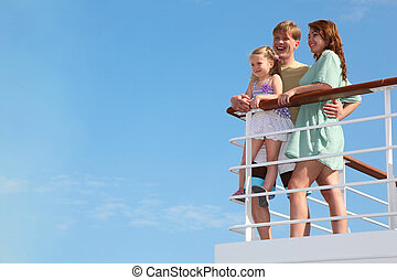 young family has summer leisure in cruise on motor ship