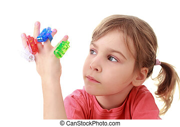 Girl looks at flashlights which are on fingers