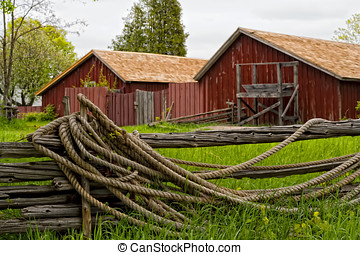 Wood Fence and old Barns in Background - A rural scene of...