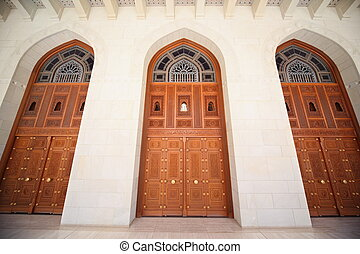 three doors of building inside Grand Mosque in Oman. wide angle.