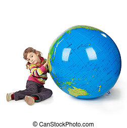 small girl with enormous globe select place, where she will...