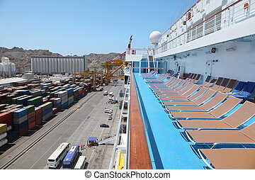 big cruise ship in port in right side of image embarkation...