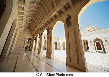 building with arcs inside Grand Mosque in Oman wide angle...