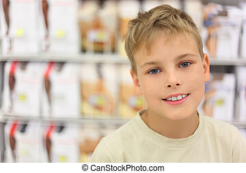 portrait of little caucasian boy smiling and looking at...