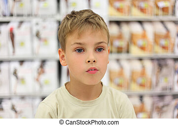 portrait of little caucasian boy looking at side, counter in...