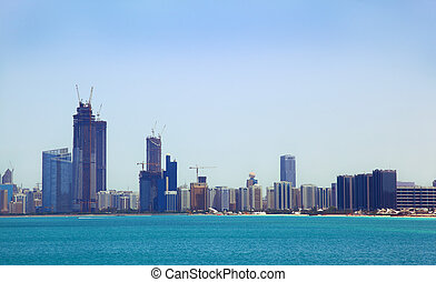 The view from the sea of the buildings and skyscrapers in...
