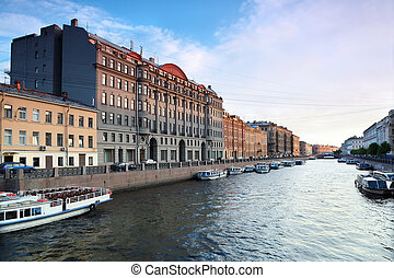 View of St. Petersburg. River channel with boats in...