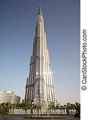 DUBAI - APRIL 18: Burj Dubai skyscraper, square with fountains, sunny day, vertical, 18 april 2010 in Dubai, UAE