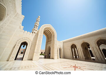 beautiful architecture inside Grand Mosque in Oman. arcs, tower.