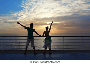 man and woman standing on deck of cruise ship and looking away