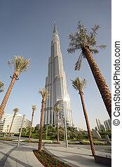 DUBAI - APRIL 18: Burj Dubai skyscraper, square with palms, sunny day, 18 april 2010 in Dubai, UAE