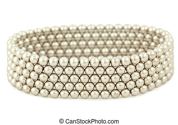 Bangle from silvery beads lies on  white background