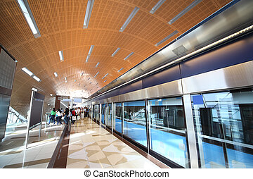 subway station in Dubai, people and train in motion blur