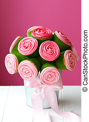 Cupcake bouquet - Bouquet of rose cupcakes tied with a...