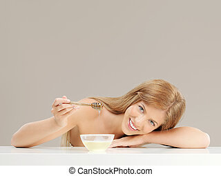 beauty portrait of woman with honey, smiling - beauty...