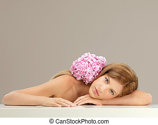 beautiful woman with pink hydrangea on shoulder - beauty...