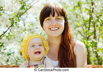 Happy mother with baby  in spring