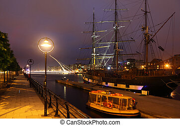 View over the river Liffey at night. Liffey is a river in Ireland, which flows through the centre of Dublin.