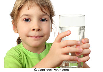 portrait of little girl in green shirt holding glass with water and looking at camera