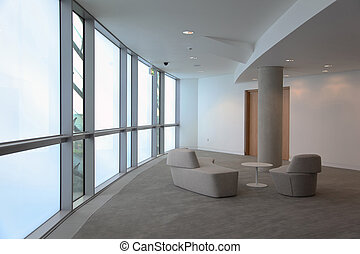 sofa, table and armchair. Stylish, bright room with large windows