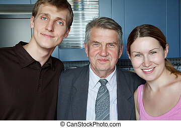 Family of three people Man, old man and girl smiling looking...