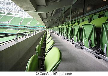 DUBLIN - JUNE 10: Many rows of green, plastic, folding seats in a big empty stadium Aviva June 10, 2010 in Dublin. Stadium Aviva after repair