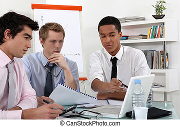 Young business professional discussing the results of a...