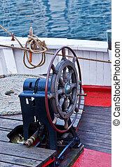 Old marine steering wheel on sailboat